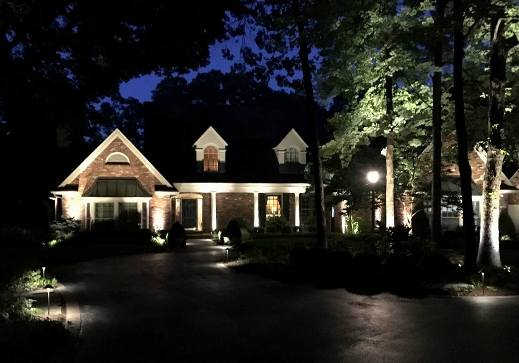 landscape lighting outside of a house